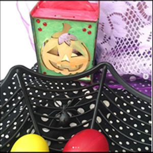 Image of a Halloween pumpkin and a basket that looks like a spider web.